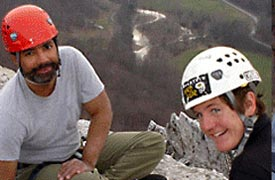 Two people in climber's helmets