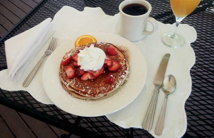Ipswich Inn Breakfast pancakes strawberries whipped cream