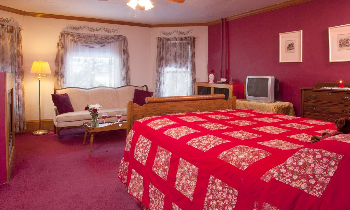 Sawyer House Wild Rose room bed couch pink walls and carpet