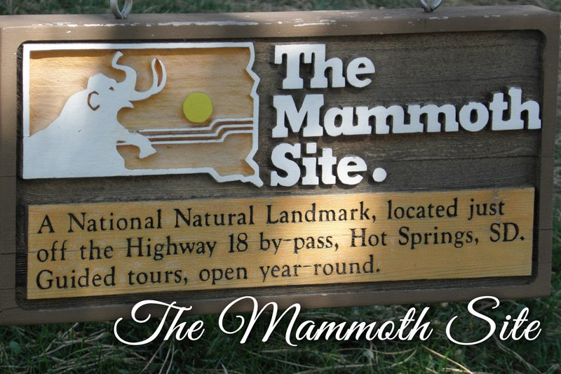 The Mammoth Site. sign A National Natural Landmark, located just off the Highway 18 by-pass, Hot Springs, SD. Guided tours, open year-round.