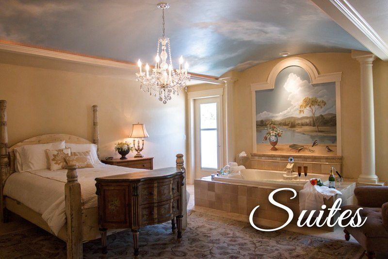 Suites - bedroom with queen bed and luxury bathtub