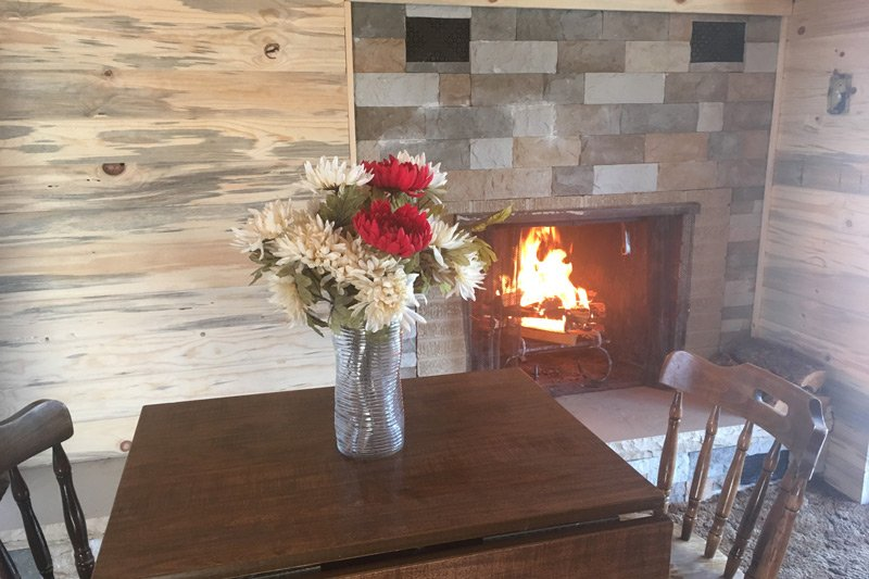 Estes Lake Lodge Mountainside Lodge downstairs deluxe table chairs flowers fireplace