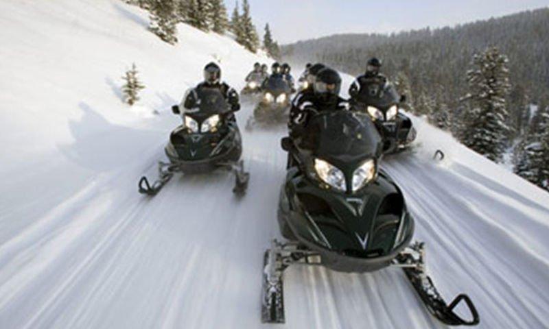 guys on snowmobiles