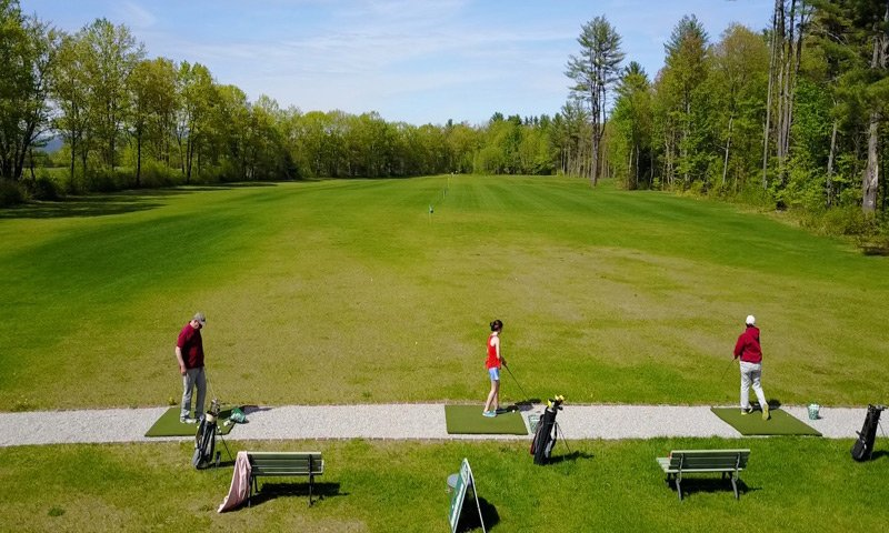 Old Saco Inn Golfing golfers on driving range