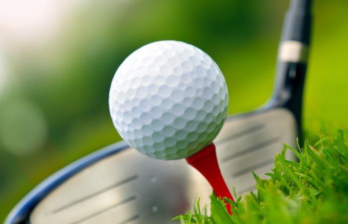 White Birch Inn golf ball on tee and club on green