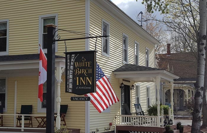 White Birch Inn exterior sign and flags