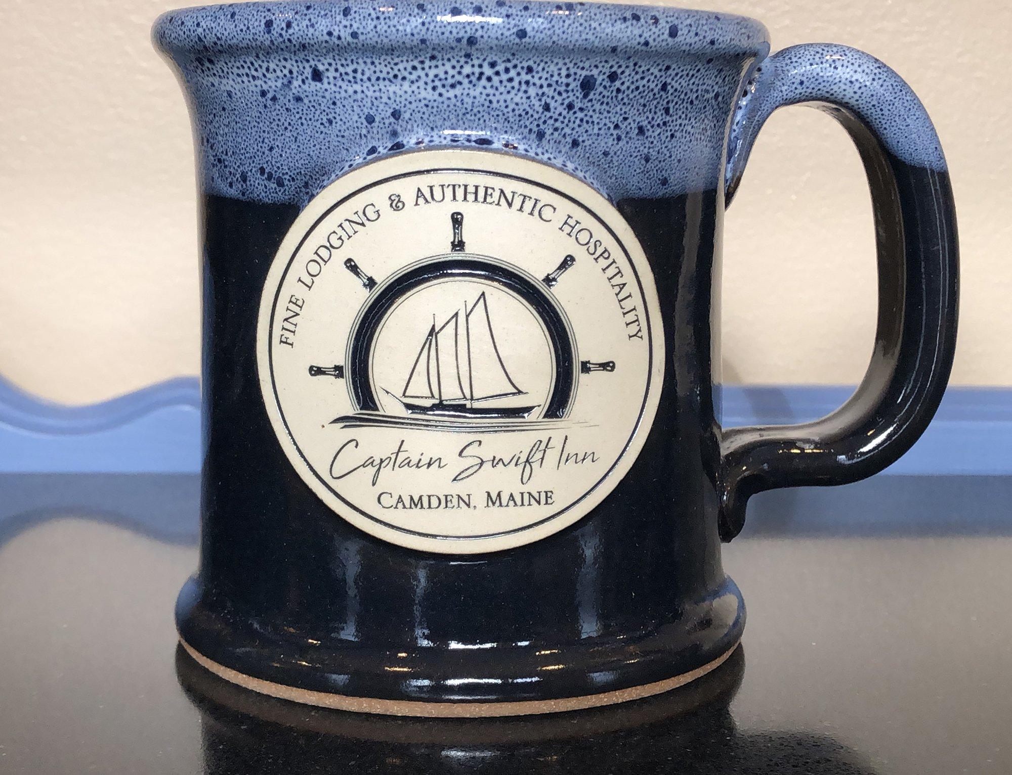tall blue mug with logo