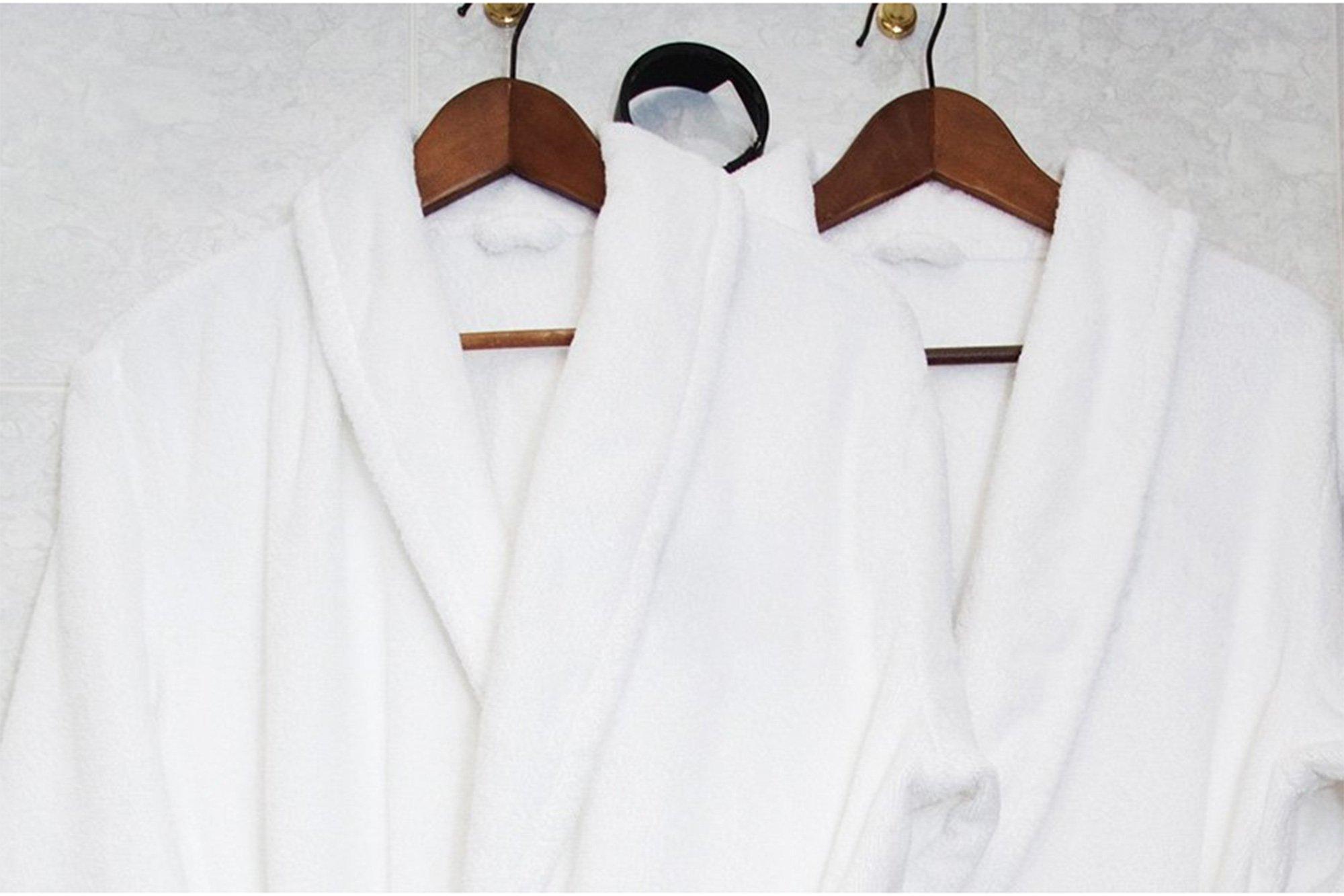 white robe hanging on bathroom door