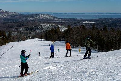 people skiing down the mountain