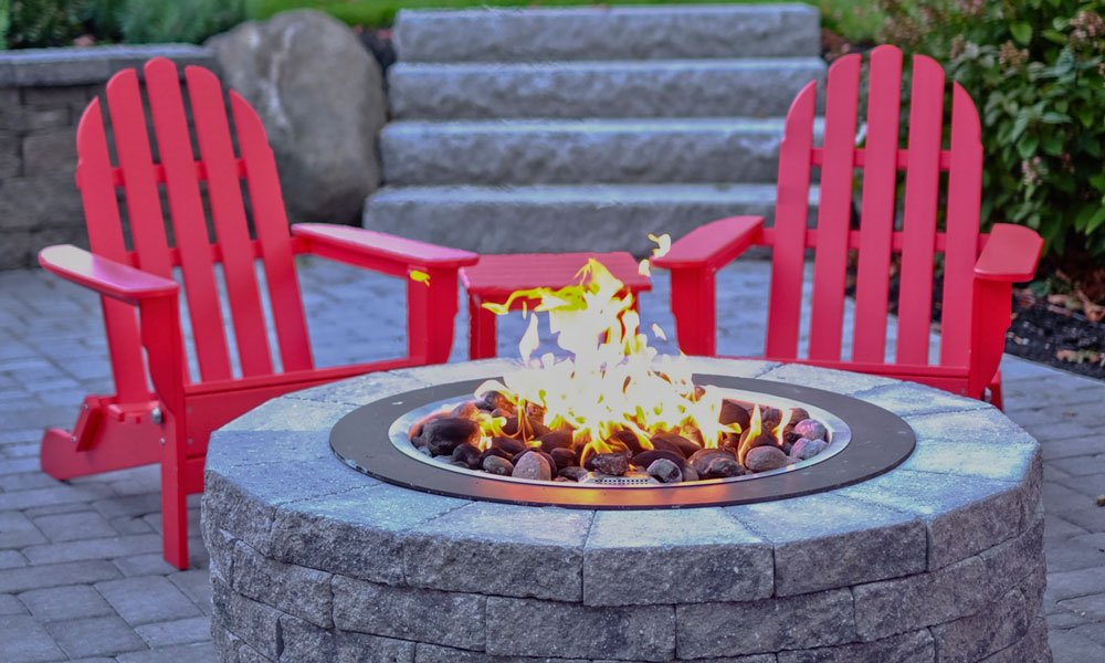 Adirondack Chairs net to a gas firepit