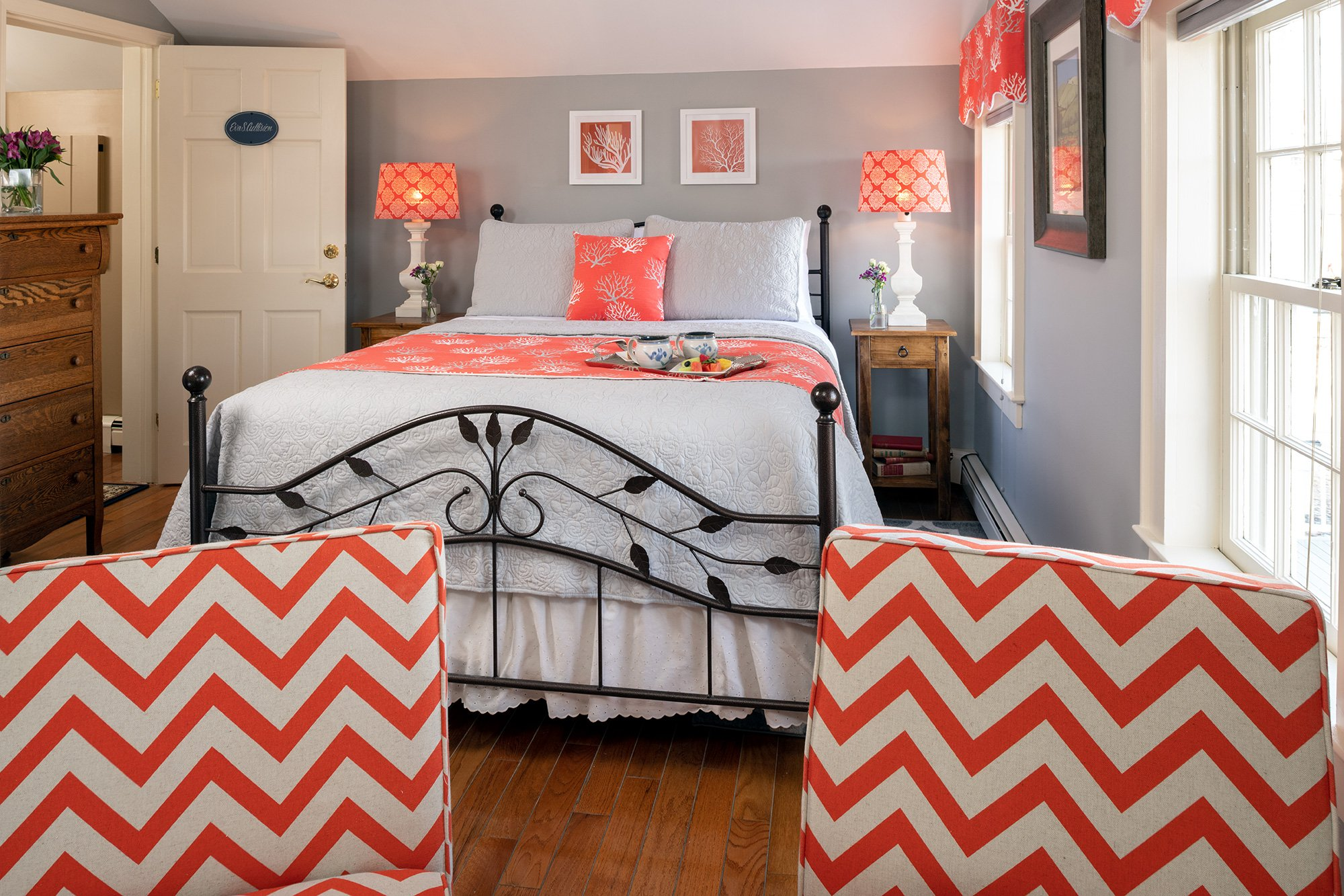 cast iron bed with orange accents