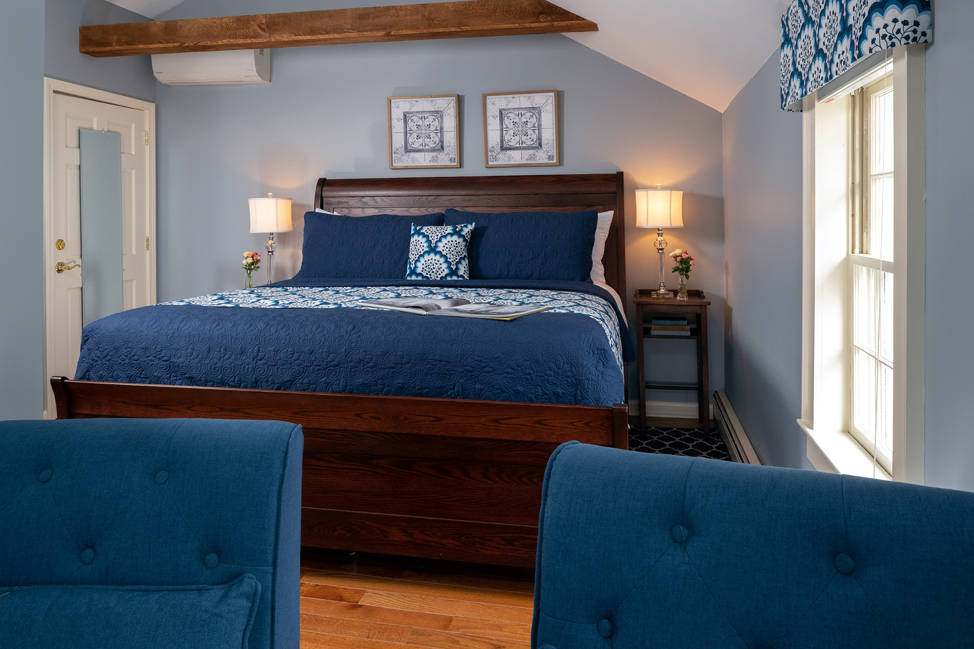 room with dark blue bedspread
