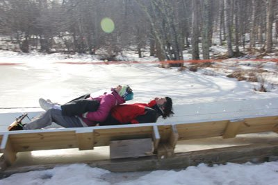 couple at the end of the toboggan run