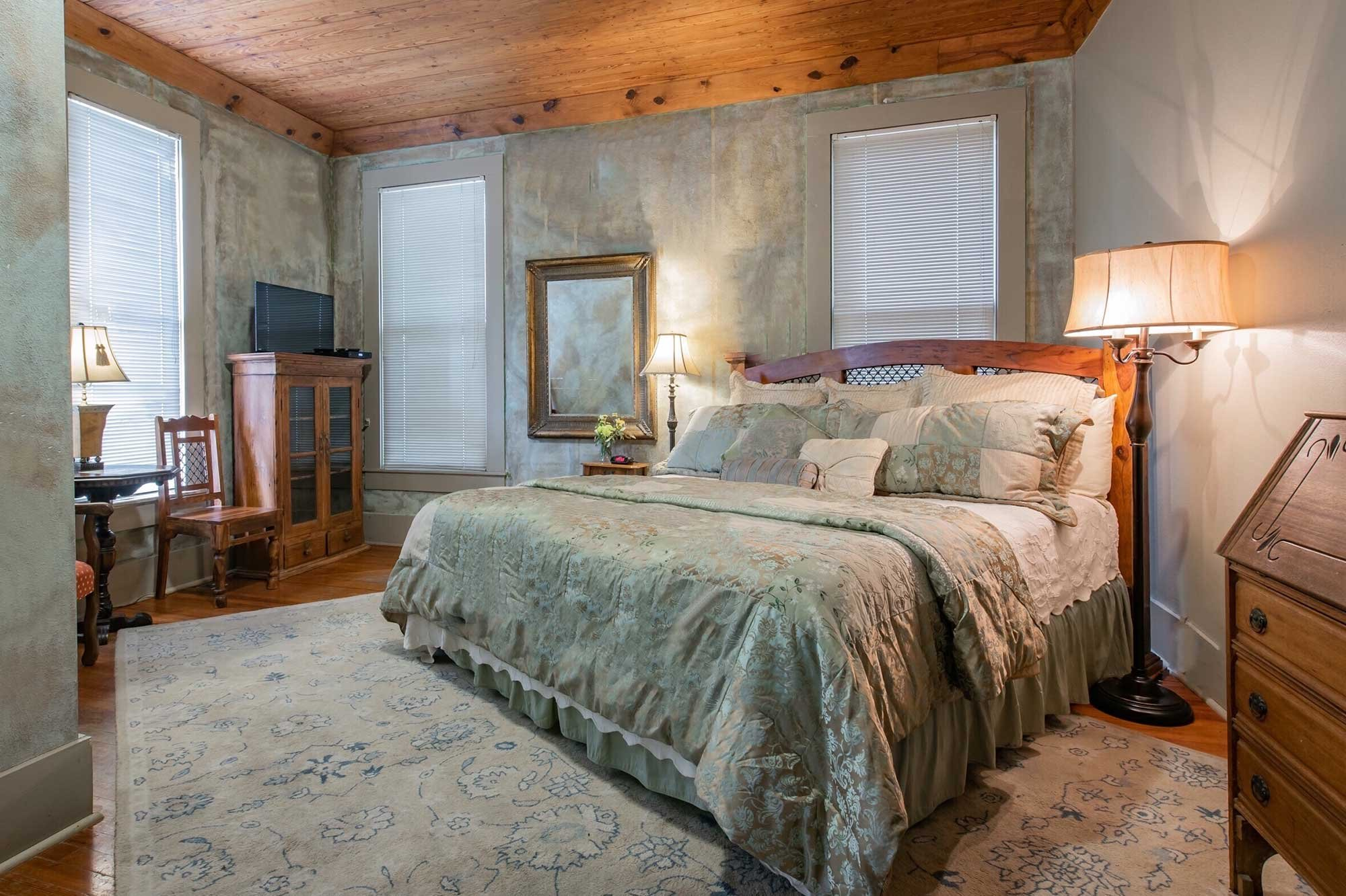 guest room with satin comforter