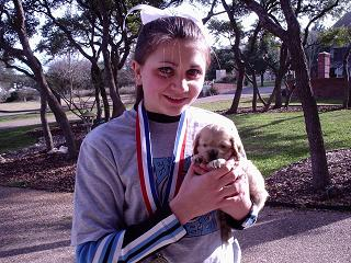 girl with tiny puppy