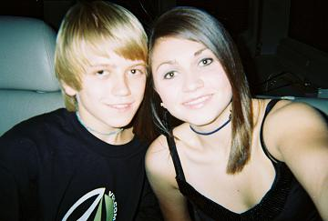 two teenagers looking at camera