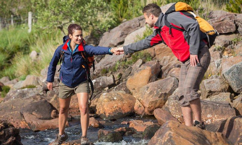 PJ's Lodge Adventures two people hiking around river