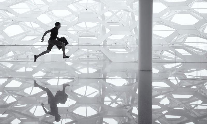 Man running with a breifcase