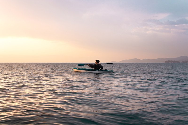 Spouter Inn Maine man sea kayaking at sunset
