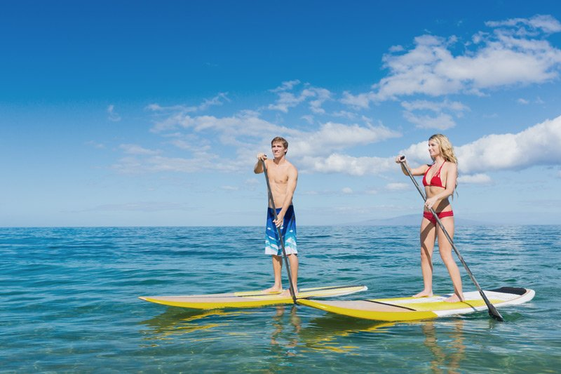 Spouter Inn Maine man and woman paddle boarding