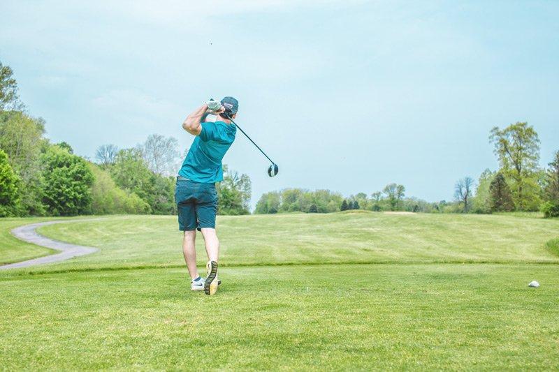 Spouter Inn Maine man golfing