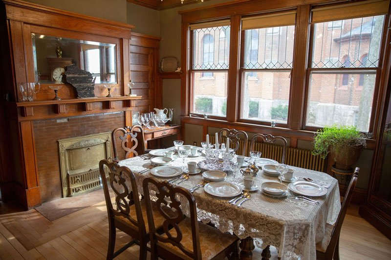 Set dining table beneath windows