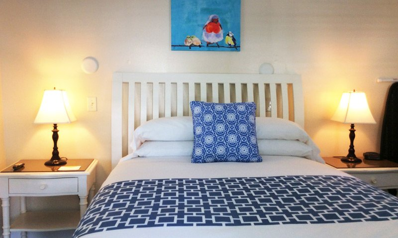 white bed with blue highlights
