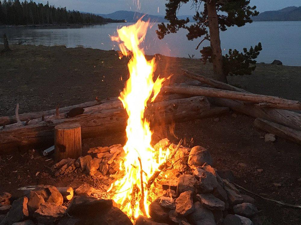 camp fire near lake
