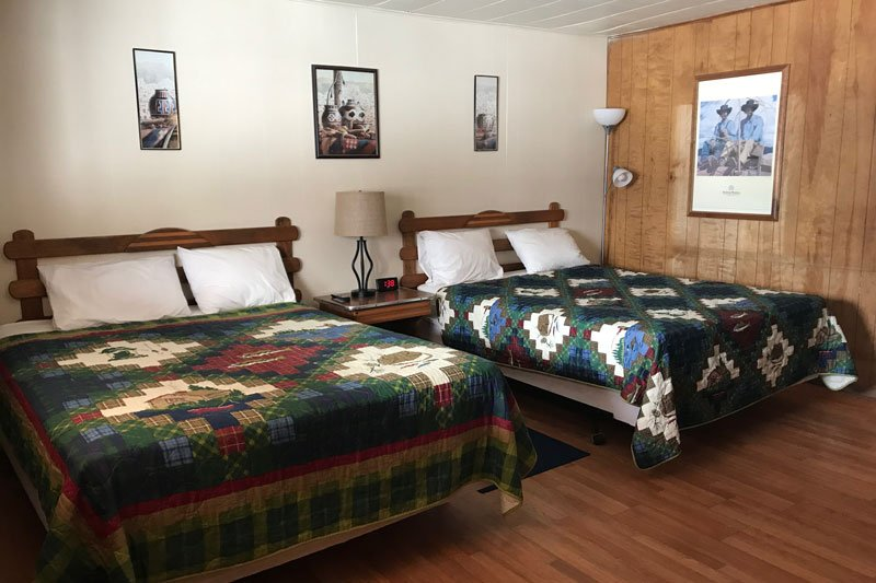 Two queen beds with quilts