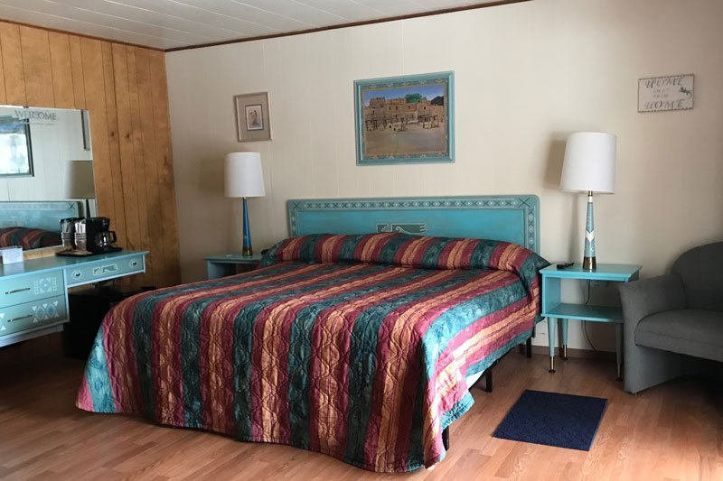 Bed with turquoise headboard