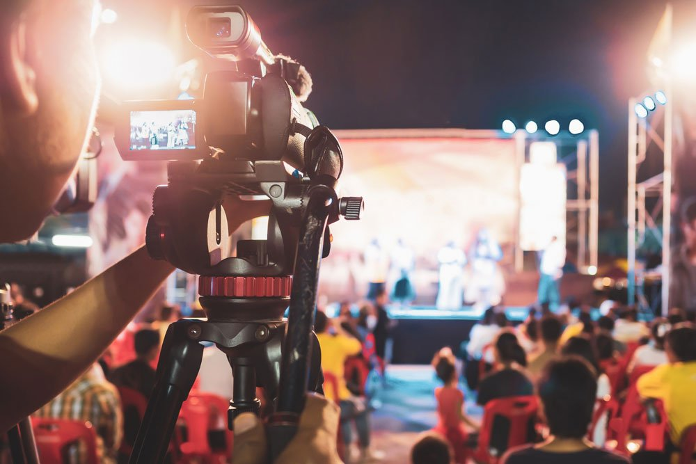 cameraman filming a live show