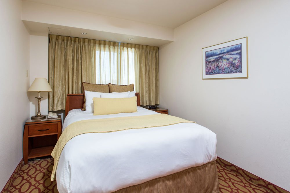 large hotel room with bed
