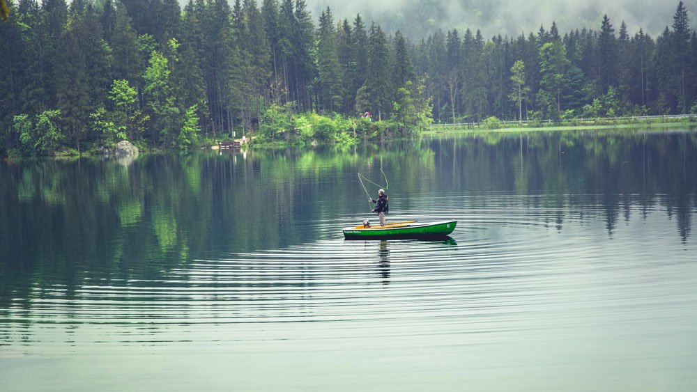 a flyfisher on a boat in the water
