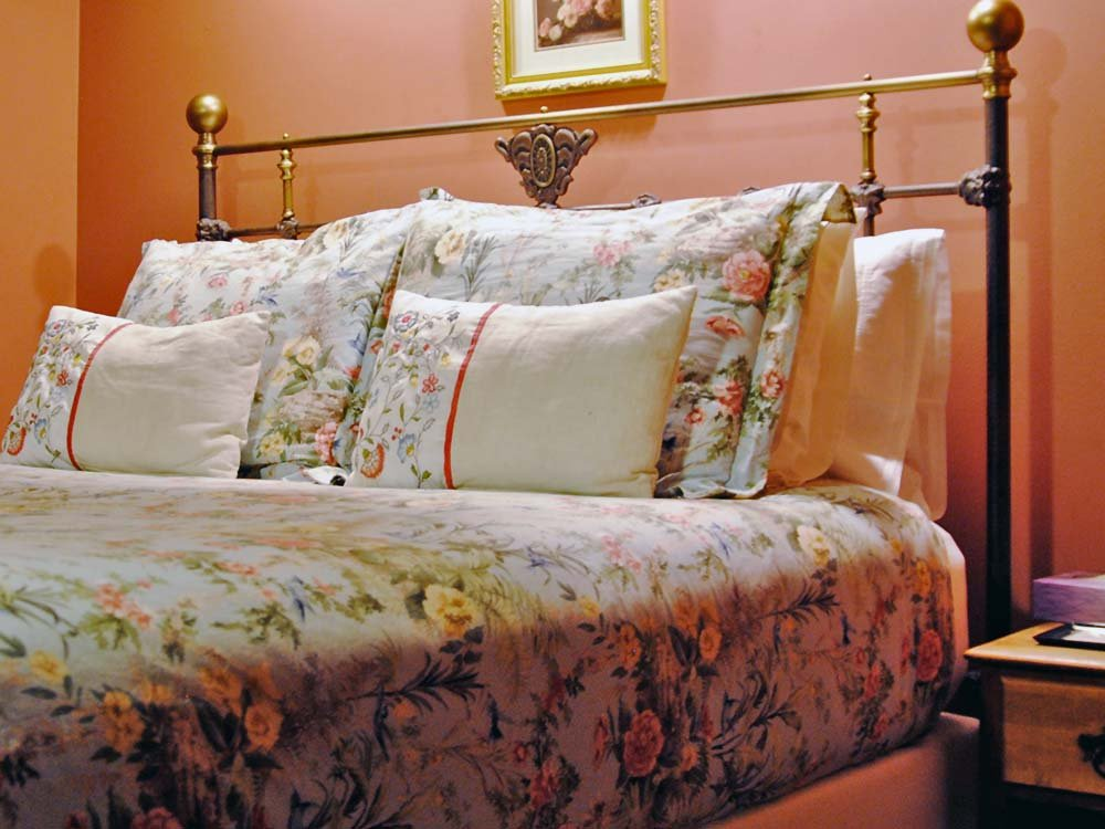floral bedding and pillows on a bed