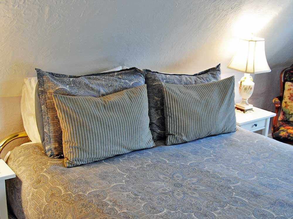 two striped decorative pillows on a bed