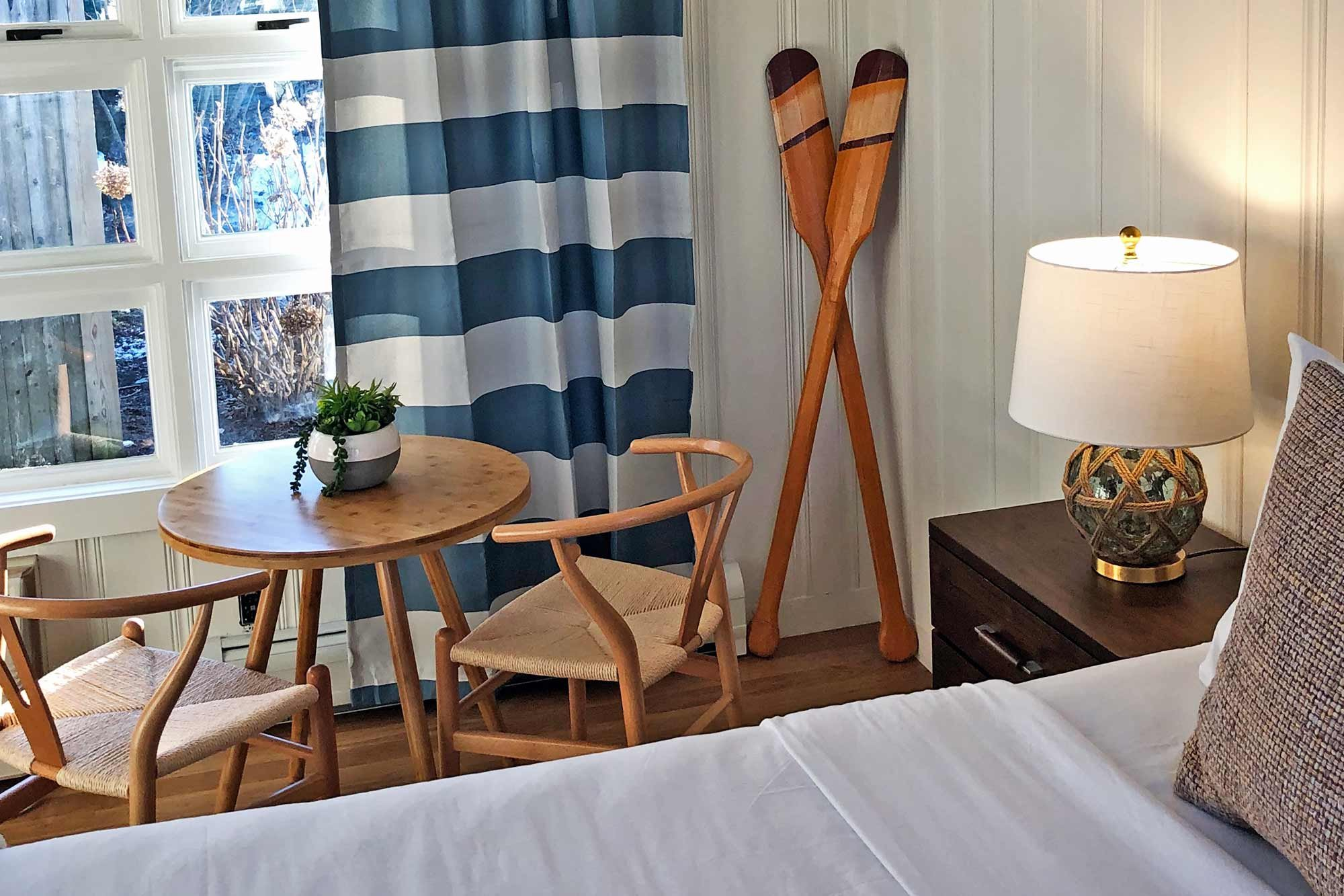 bed near table and chairs
