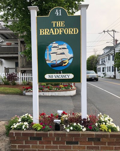 Sign that Reads The Bradford House and Motel