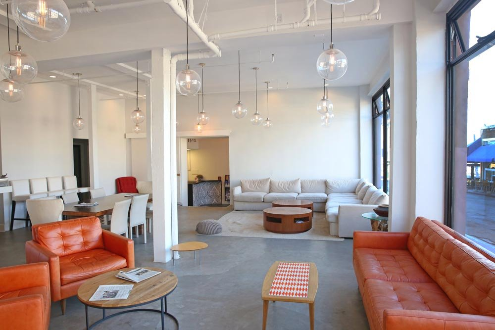 Front lobby with orange sofas