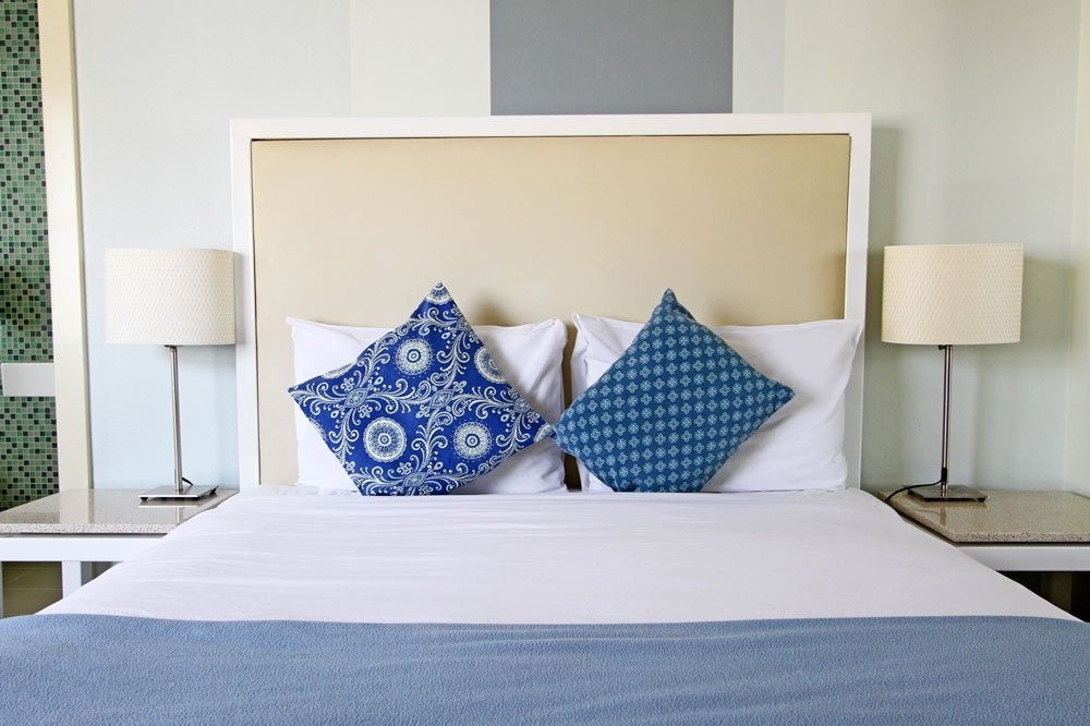 Bed with blue throw pillows