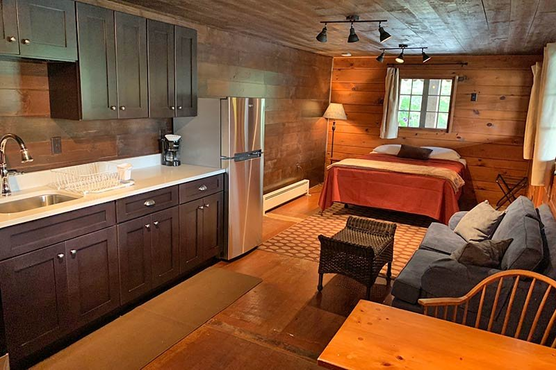 bed, couch, and kitchen studio lodging