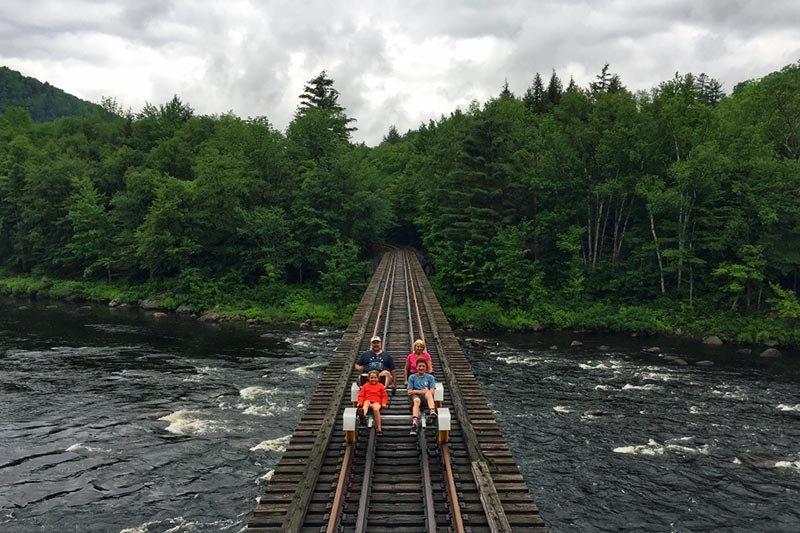 people on railroad tracks