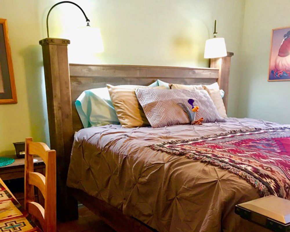 Red Quilt and Pillows on Bed