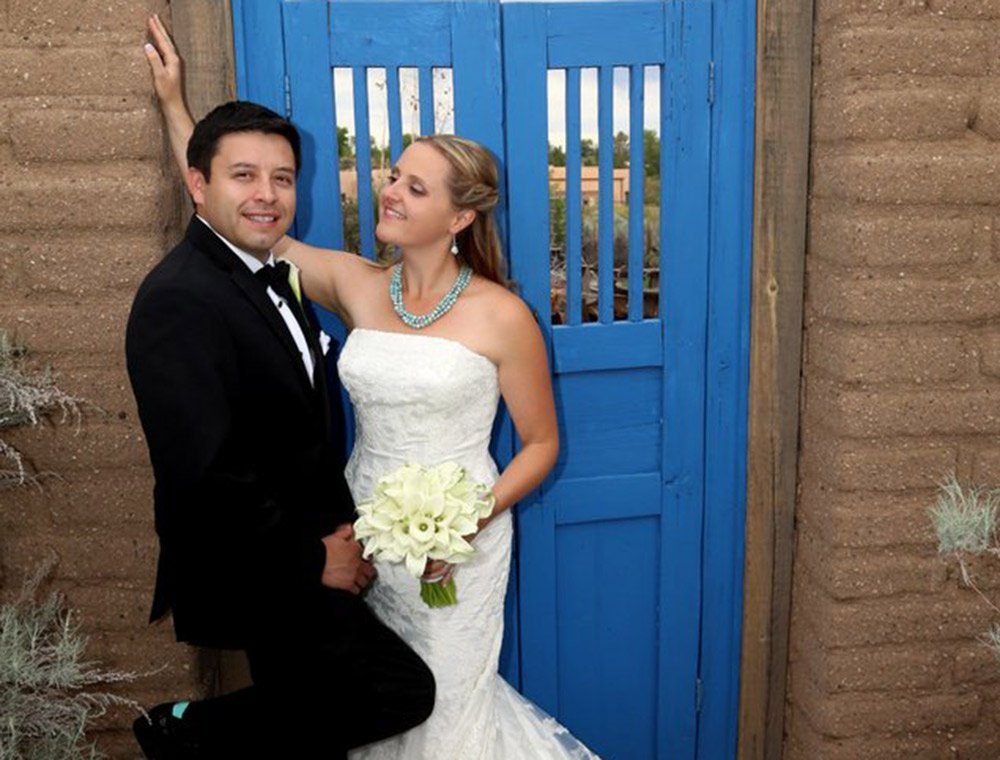 Bride and Groom in front of blue gate