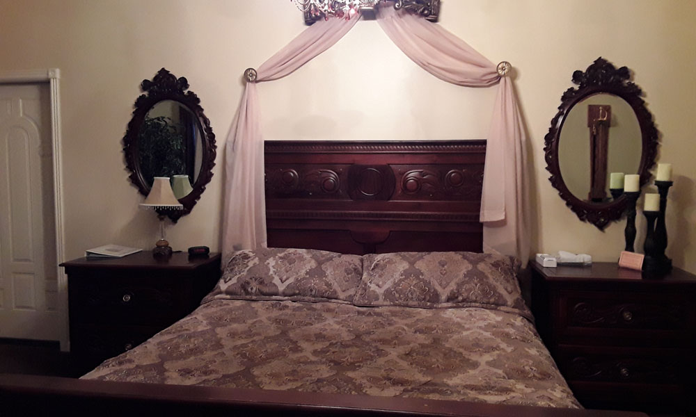 bed framed with curtain
