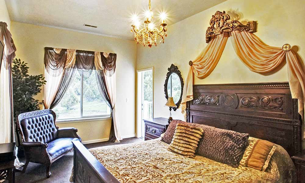 bed with ornate bedframe and private entrance