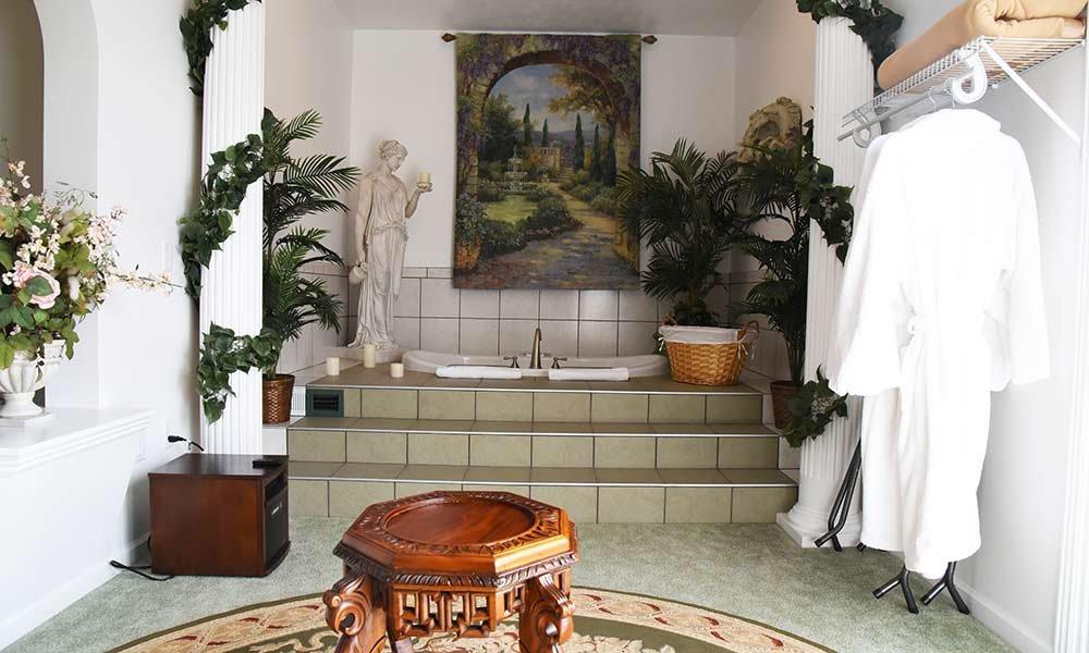 bathtub with roman decor