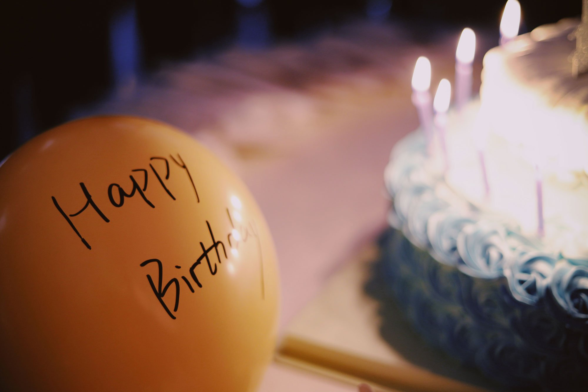 """orange balloon with """"happy birthday"""" written on it"""