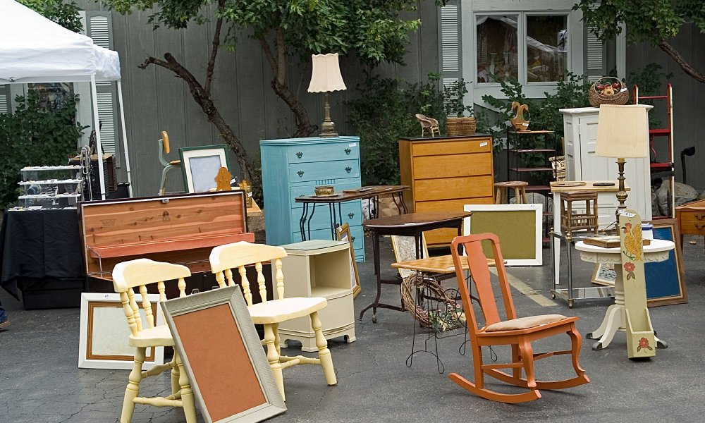 chairs and other furniture outside antique shop