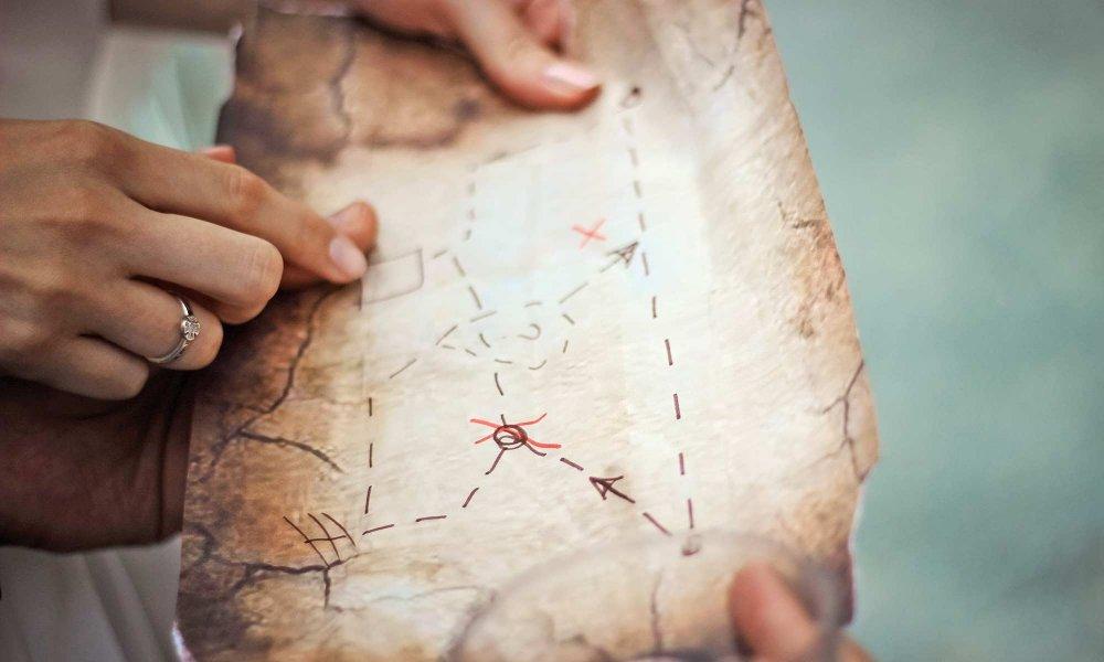 pointing at a treasure map
