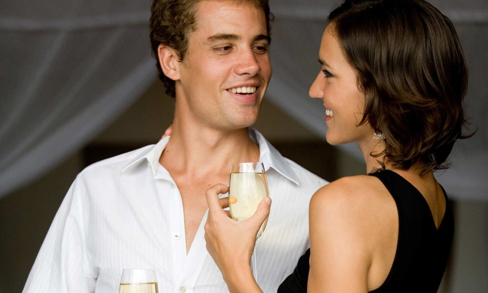 couple dancing holding champagne